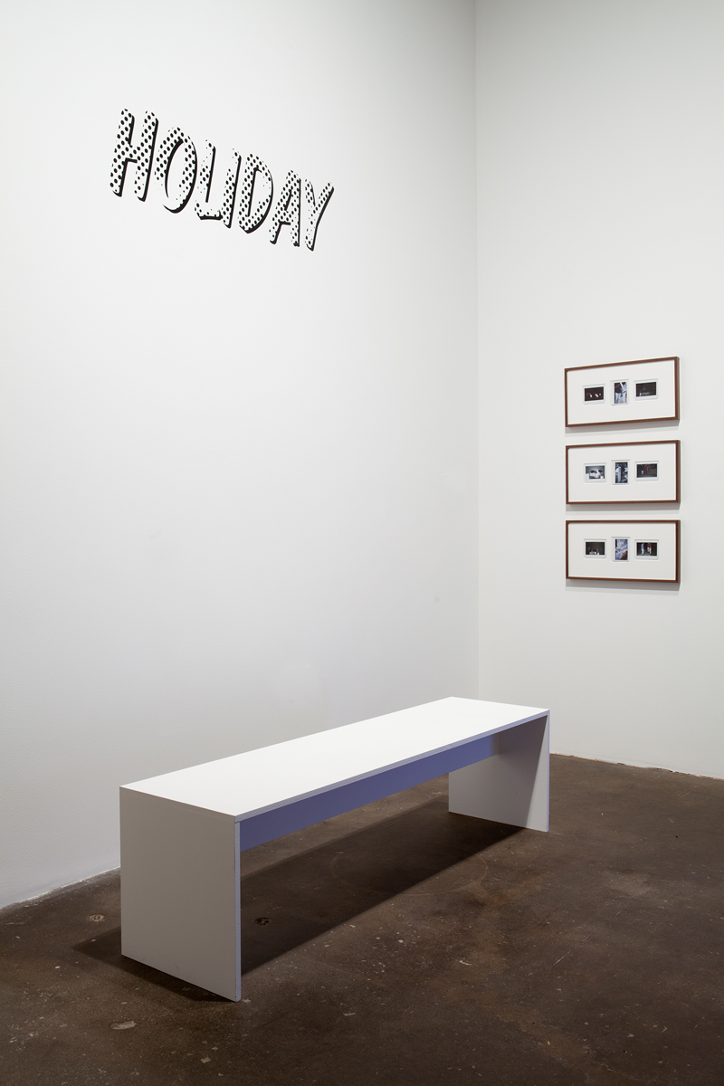 TOBIAS KASPAR, installation view. Holiday, detail, 2013. Bench, three walnut frames with 9 fuji instax photographs, two monitors, two changing rooms with mirrors, folding chairs and one pair of Holiday jeans, garment rack with 9 pair of Holiday jeans, vinyl text. Dimensions variable.