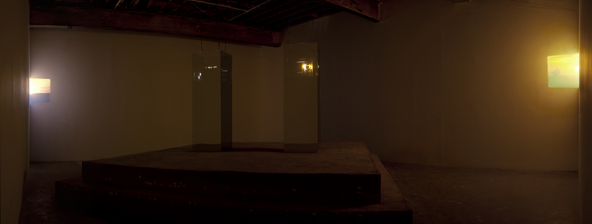 Before the Sun, 2010. Two channel looping 16mm film installation with optical sound, rammed earth, shells, mirror pane glass and mason's line. Dimensions variable.