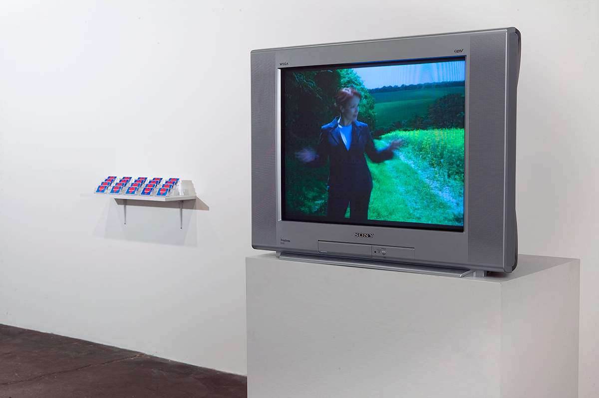 Consideration, installation view. Left: Donorcard (for Midway Contemporary Art), 2007. Edition of 1500 unique cards signed by the artist and to be signed by the viewer. Right: Terms and Conditions, 2004. Single channel video (DVD), color, sound. 3 minutes 25 seconds.