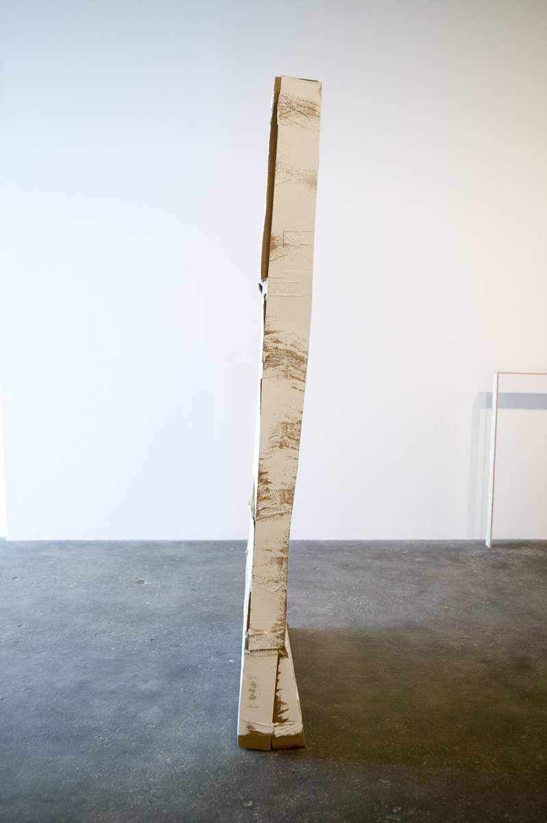 Foreground: Hollow, 2006-2007. Cardboard, latex paint, packing tape. Background: So, 2007. Plywood, wood glue.