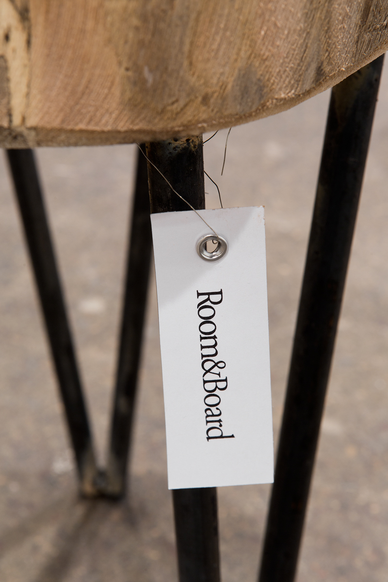 Short Stool (Gamofena), detail, 2016. Wood, steel, and tag. 11 ½ x 15 x 19 inches.