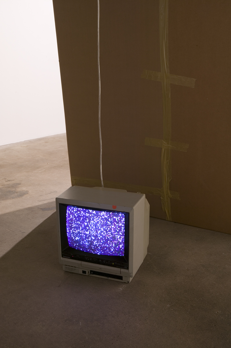 Shhhh, detail, 2007. Cardboard, packing tape, VHS (90 minutes).