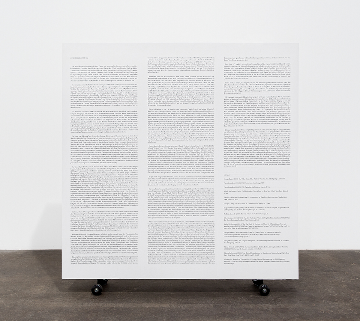 Side A: Text in lieu of an object, 2014. Plywood, pine, printed text, flashe, wheels. 51 x 48 x 6 inches.