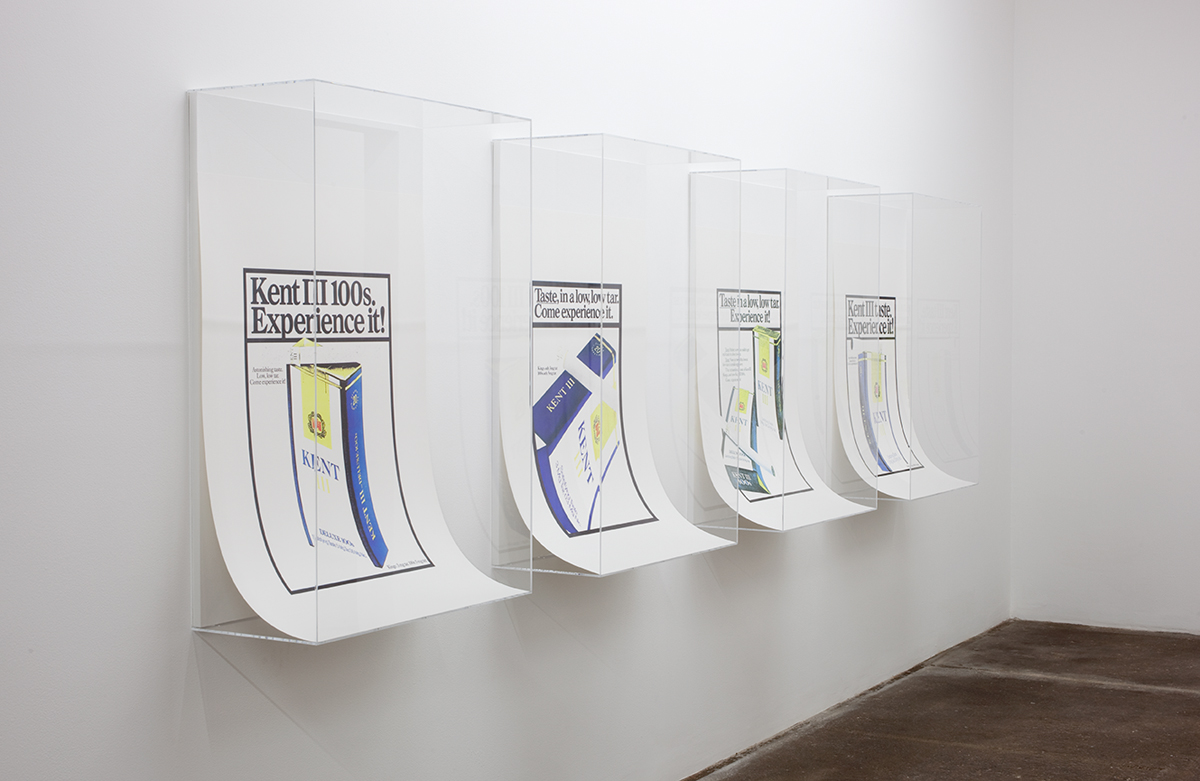 David Catherall, installation view. Left to right: KENT III Experience / Taste: KENT III 100s Experience It; KENT III Come Experience It; KENT III Taste Experience It; KENT III Experience It, each 2012. Silkscreen on Design Offset, Naturweiß 300 gm. paper, plexiglas. 47 ¾ x 29 x 12 inches each. 47 ¾ x 151 ¼ x 12 inches installed.