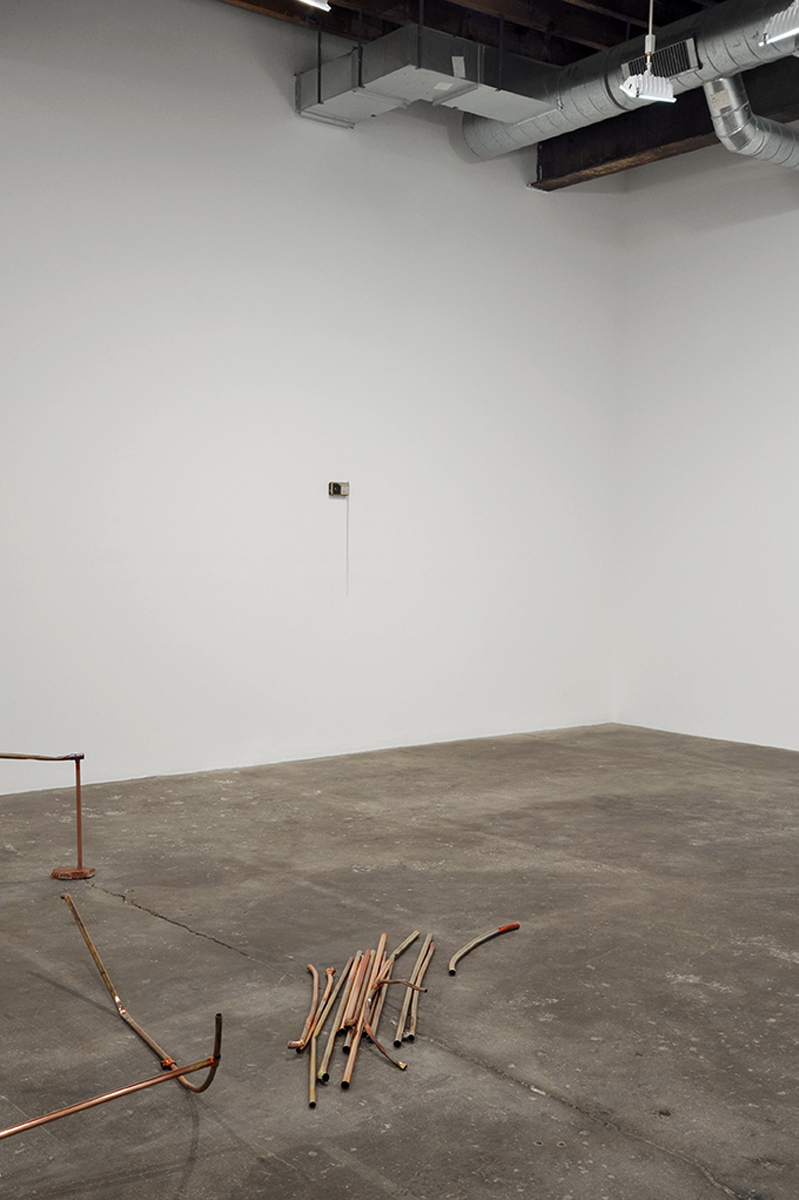 Stray Warmings, installation view. Foreground: Stray Warmings, 2013. Background: Strays, 2013.