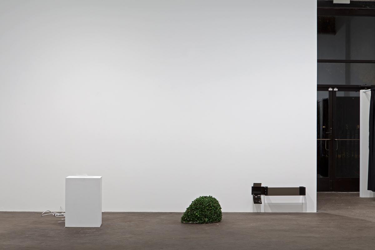 TOBIAS KASPAR, installation view. Core Lux, 2013. MDF pedestal, white paint, aluminum foil, aluminum foil tape, humidifier, acrylic, boxwood, Oasis foam. 100 x 60 x 24 inches.