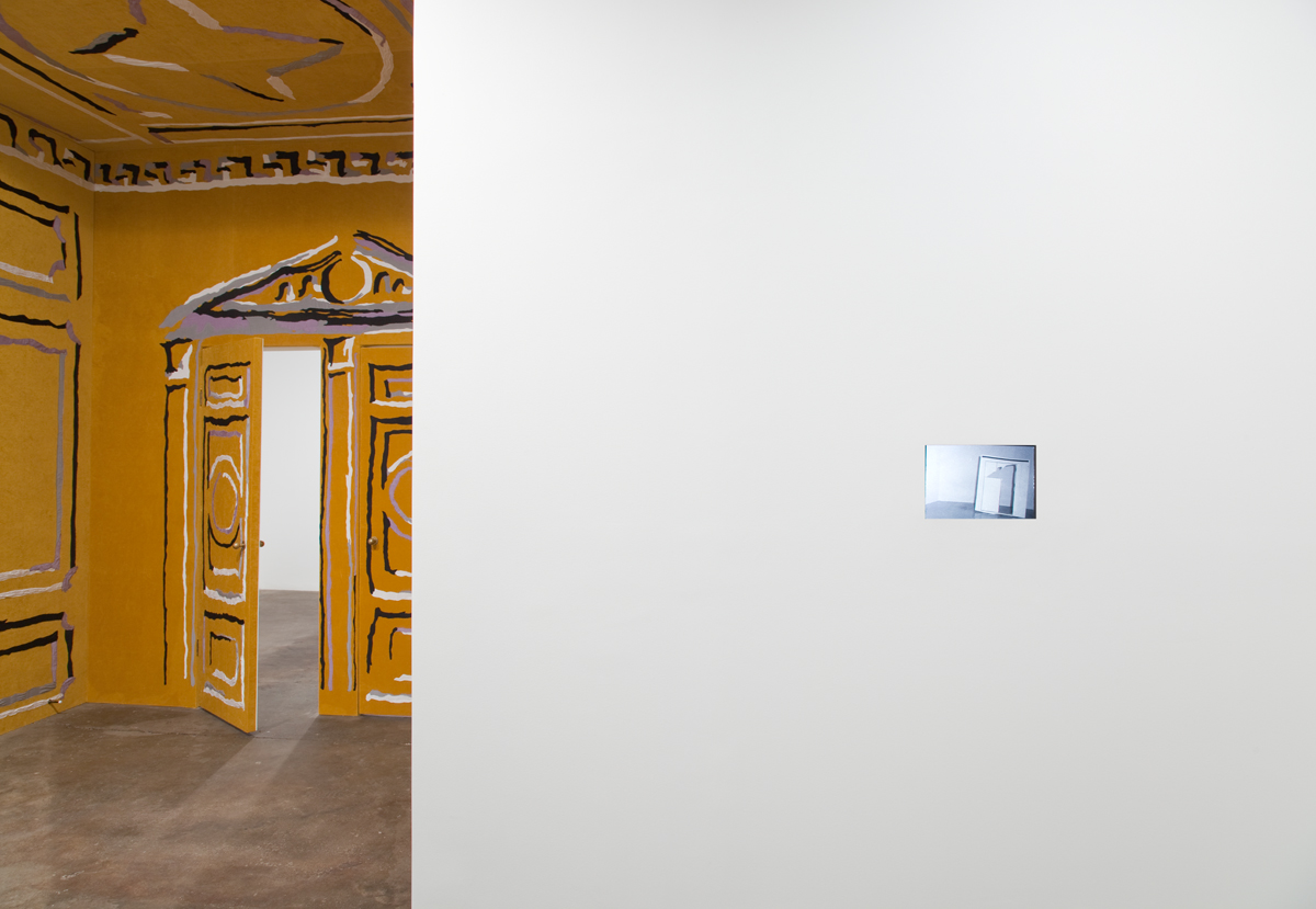 Perforations, installation view. Left: Concern, crush, desire, 2011. Cotton appliqué on velvet, brass doorknobs and door stoppers. 131 x 94 x 115 inches. Right: I am working without knowing too well on what, and I am writing this on the side, 2011. Color slides, lighting gels, projector. 8 x 12 inches.