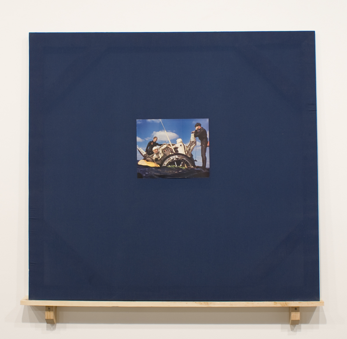 Whew, 2009. Collage on fabric panel, wood shelf. 51 x 51 inches.