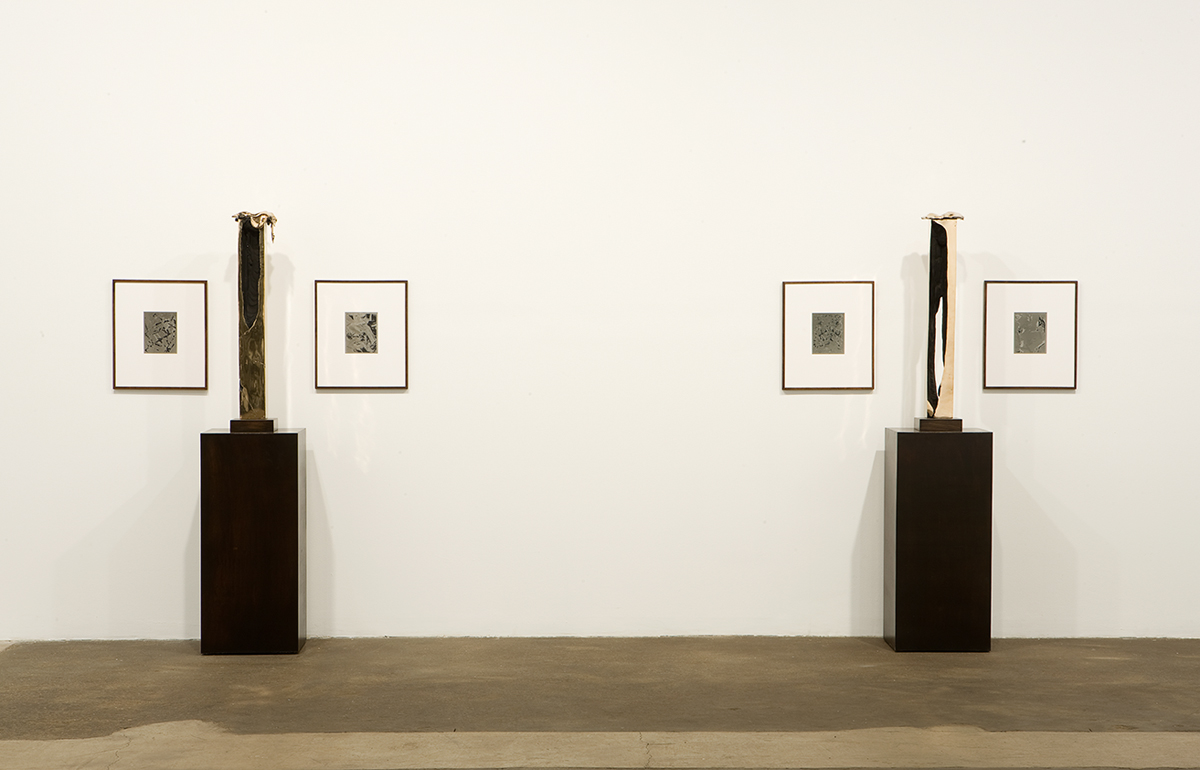 Anthony Pearson, Gallery 1 installation view. Left: Untitled (Slip Cast Slab Arrangement), 2008. Uncoated high-polished bronze sculpture, base, pedestal, two framed solarized silver gelatin photographs. 66 x 44 x 15 inches. Unique. Right: Untitled (Slip Cast Slab Arrangement), 2008. Uncoated high-polished bronze sculpture, base, pedestal, two framed solarized silver gelatin photographs. 66 x 44 x 15 inches. Unique.