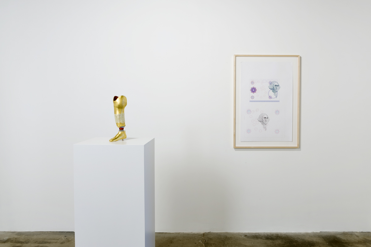 For Rent, installation view. Left: Untitled, 2007. Gilded prosthesis with Swarovski crystals. Right: Untitled, 2008. Ball point pen on paper.