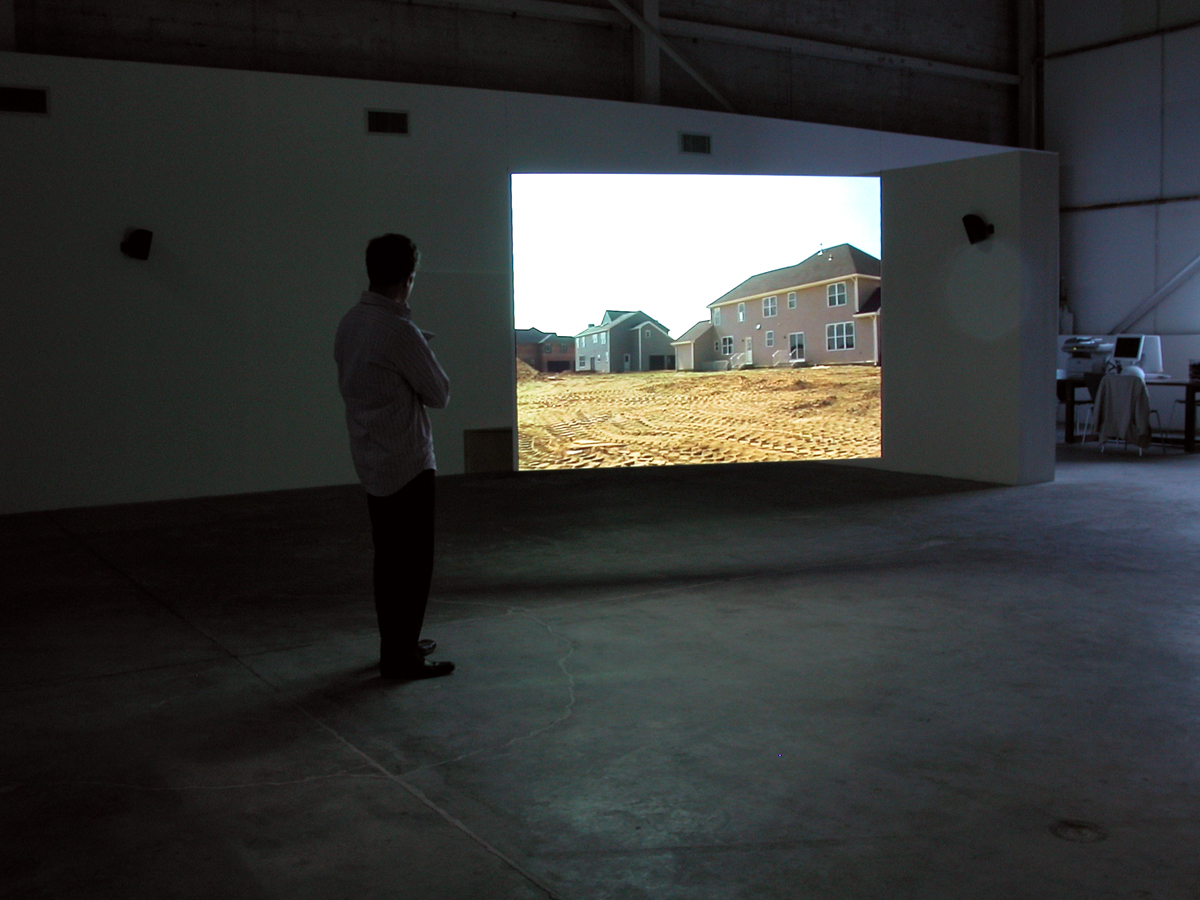 Godville, installation view, 2005. Video installation, synchronized two-channels on single having screen, sound. 51 minutes.