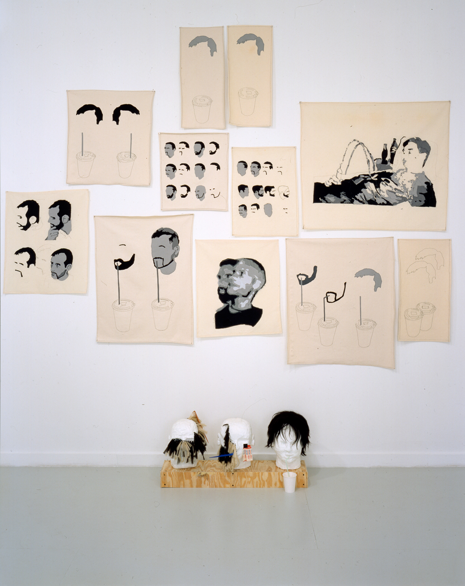 Carter. Wall: Drawings on cloth, 2001. Fabric on canvas. Floor: Heads, 2001. Mixed media.
