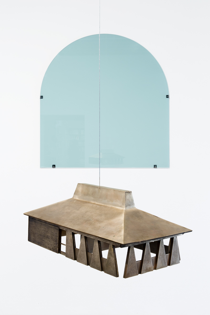ISOSCELES TRAPEZOID ARCH, installation view. Works back to front: Replacement Window #1 (Free Radical), 2016. Glass. 51 x 53 inches; and Campana (Establishment), 2016. Bronze and wire. 9 x 13 x 22-1/2 inches.