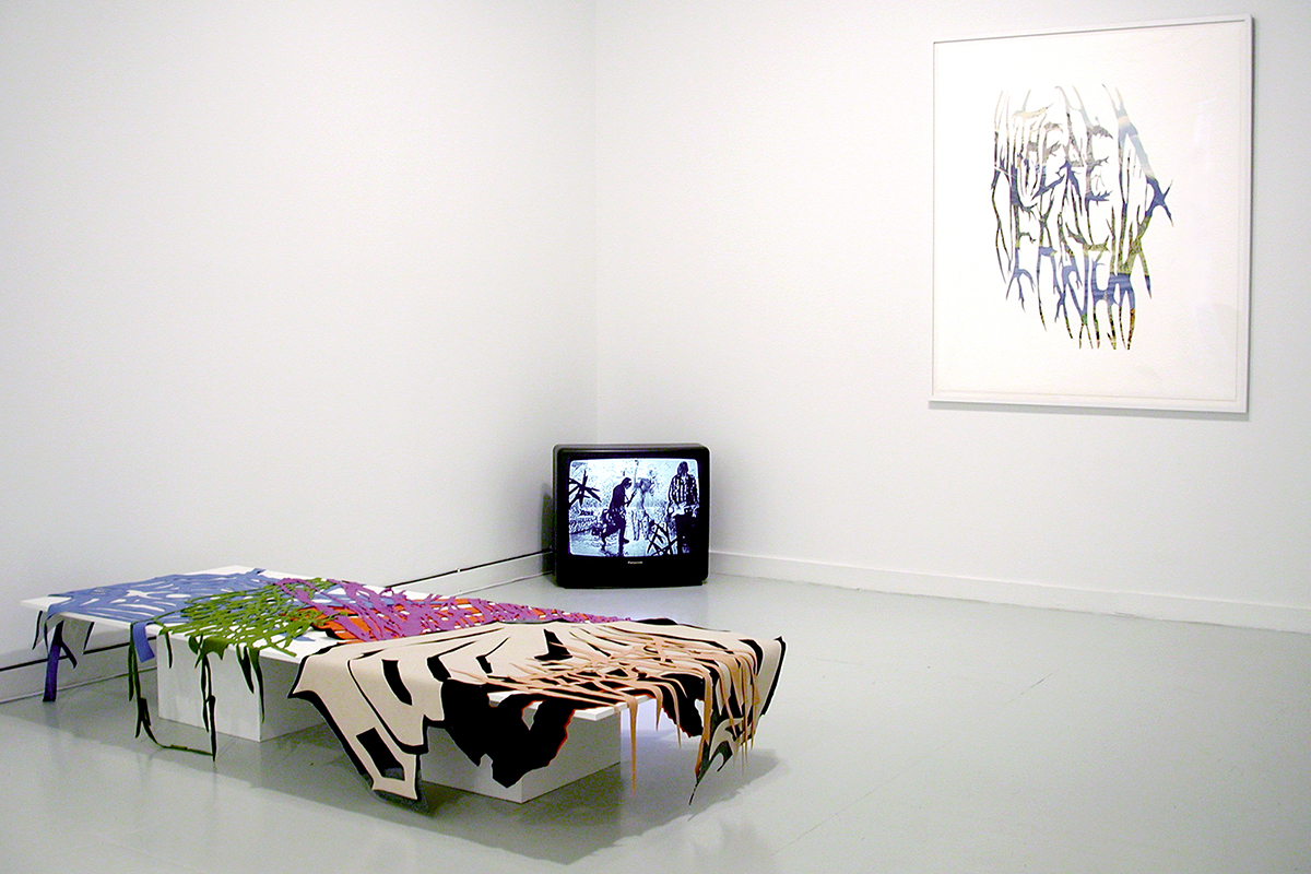 Jay Heikes and Kirk McCall, installation view. Left: Jay Heikes, Teenage Riot, 2001-2001. Wool, denim, and felt. Dimensions variable. Center: Jay Heikes, White Light, 2002. Digital video transfer to DVD, 1 Hr loop. Right: Jay Heikes, Withered Earth, 2001. Cut paper on paper. 56 x 48.5 inches, framed.